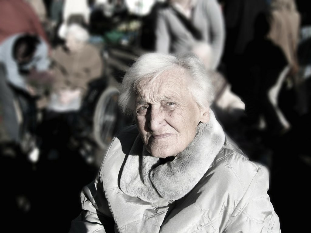 Old woman looking up at the camera